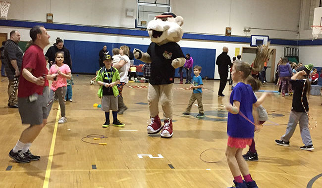 Students and adults jump rope