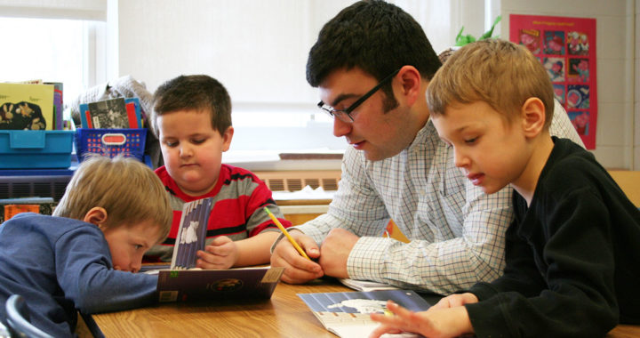 Andrew Newmark reads with students