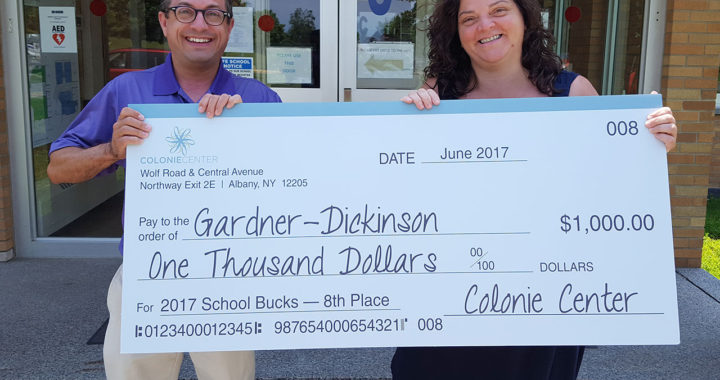 Superintendent Thomas Reardon and Principal Mary Yodis with check for school