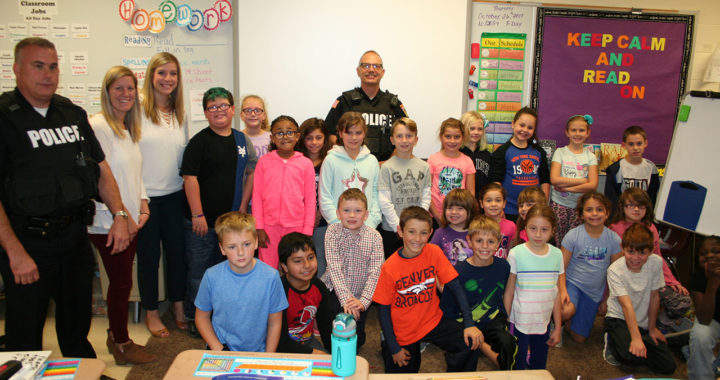 Students pose for photo with local police
