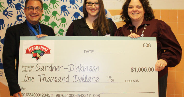 School officials receive check from Hannaford
