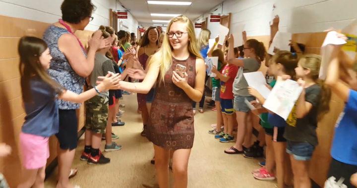 Students walk through hallway