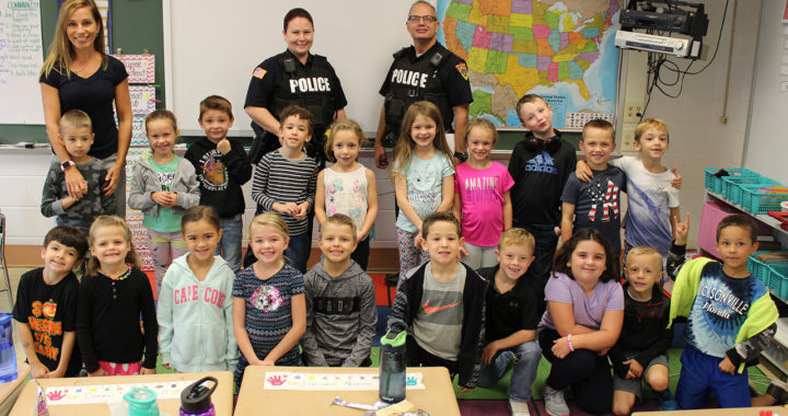 1st graders pose for photo with police
