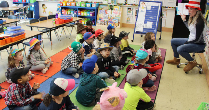 Students listen to Dr. Seuss book