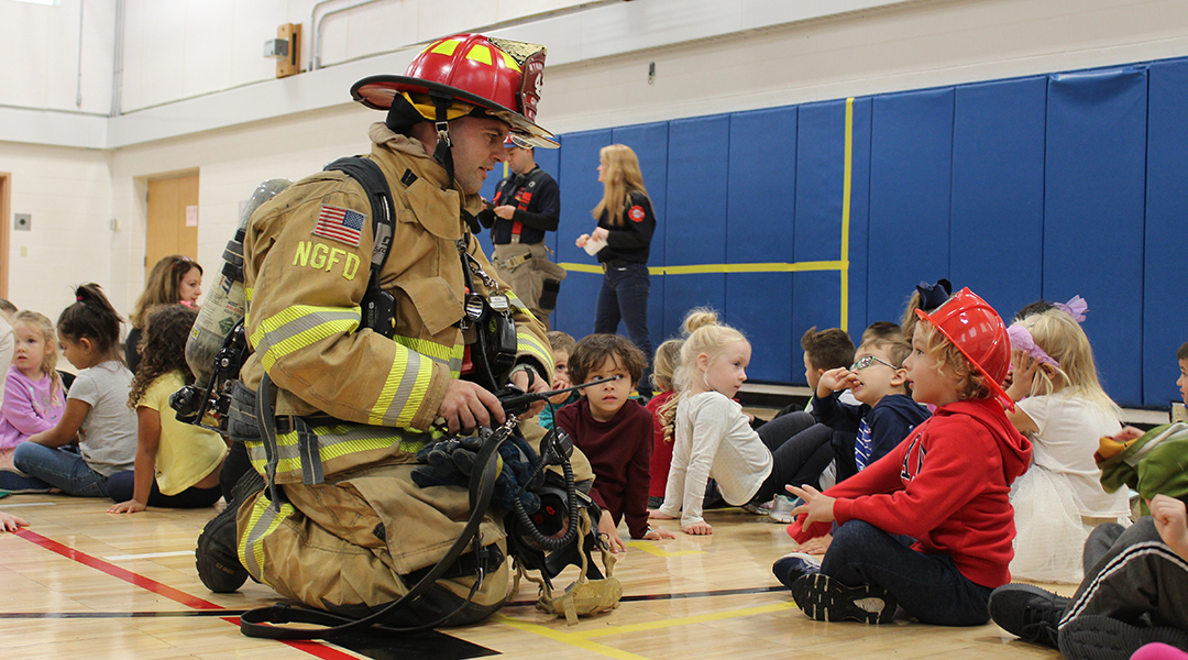 Firefighter with student