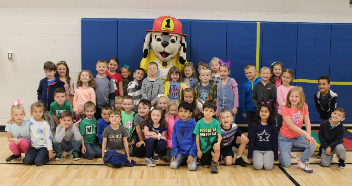 Students with fire department mascot
